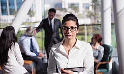 portrait of  young business woman with her glasses  at office wi