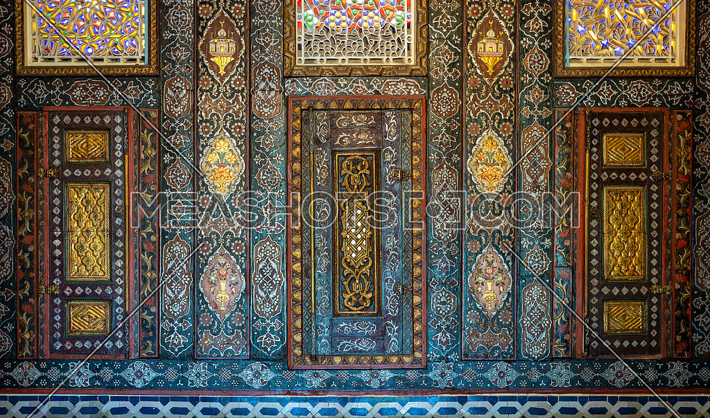Floral ornaments of wooden embedded cupboards painted with colored geometrical patterns, Syrian hall of historic Manial palace of Prince Mohammed Ali, Cairo, Egypt