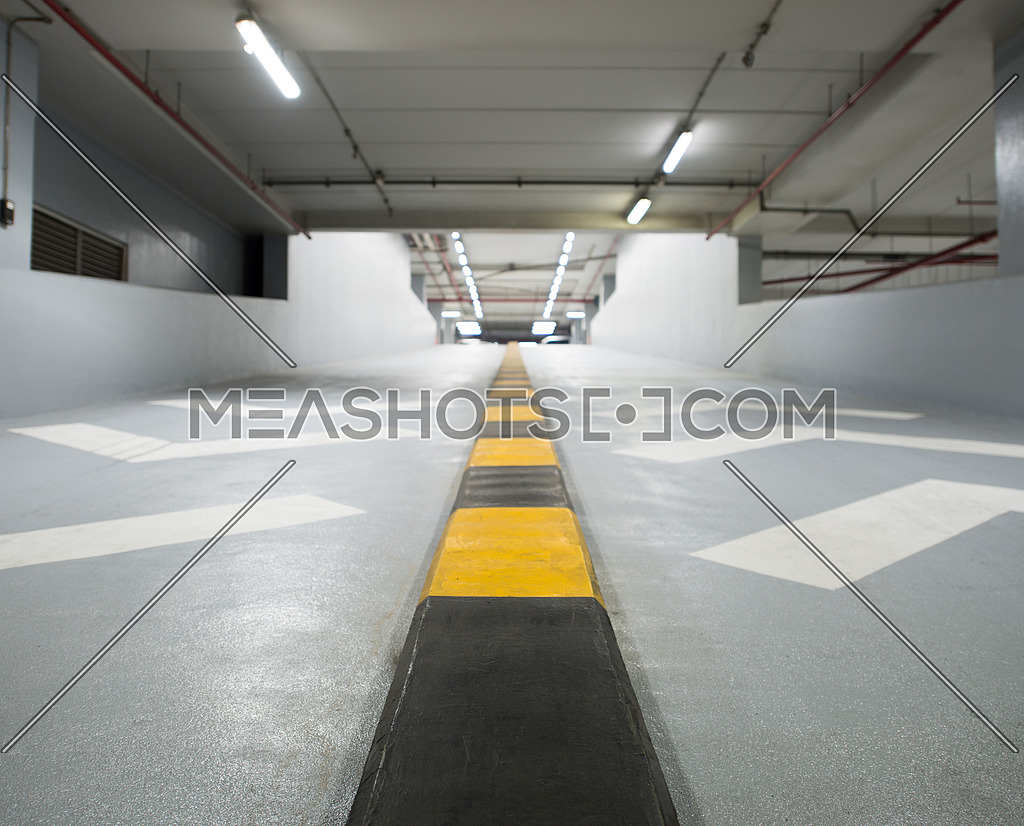 a two way ramp in an indoor parking