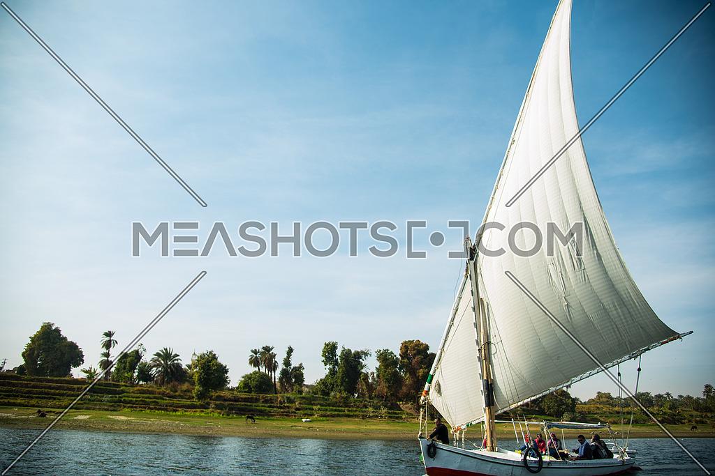 a sail boat (felouka) sailing in the nile in Aswan, EGYPT