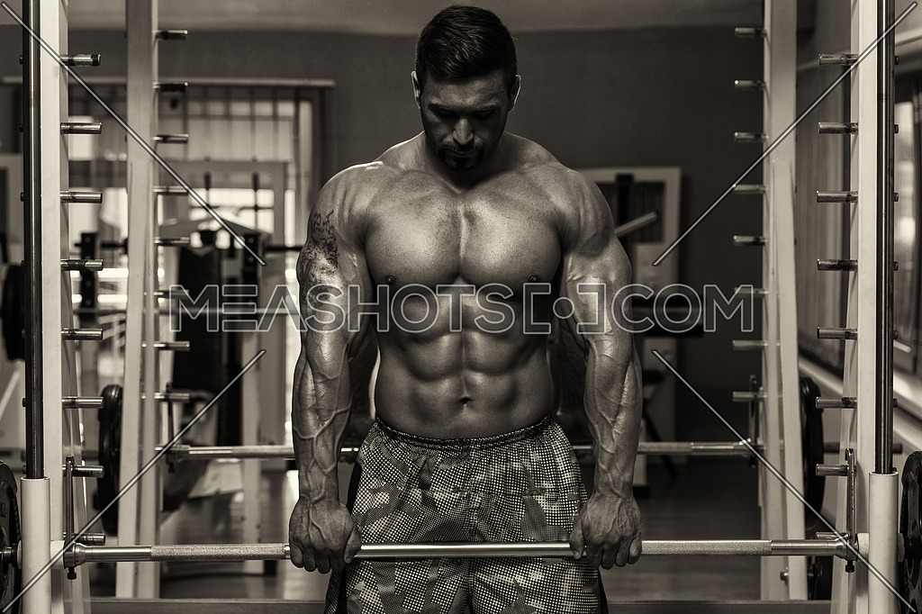 Bodybuilder Doing Heavy Weight Exercise For Trapezius