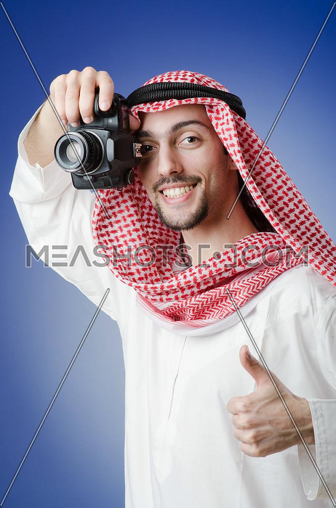 Arab photographer in studio shooting