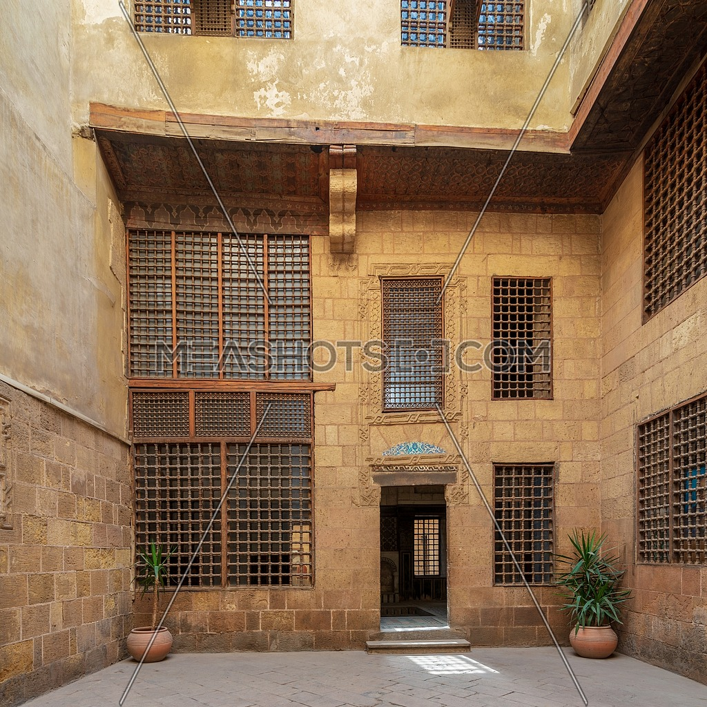 Facade of ottoman era historic house of Moustafa Gaafar Al Seleehdar, located at Al Darb Al Asfar District, Cairo, Egypt, with interleaved wooden windows (Mashrabiya)