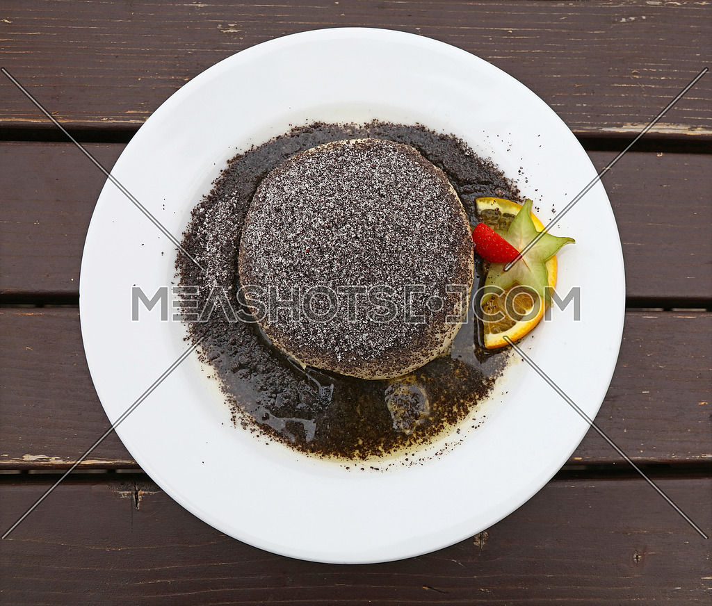 Parena buchta, steamed sweet dumpling bun topped with poppy seeds, sugar and butter, traditional in Slovakia, Hungary and Austria, close up, elevated top view, directly above