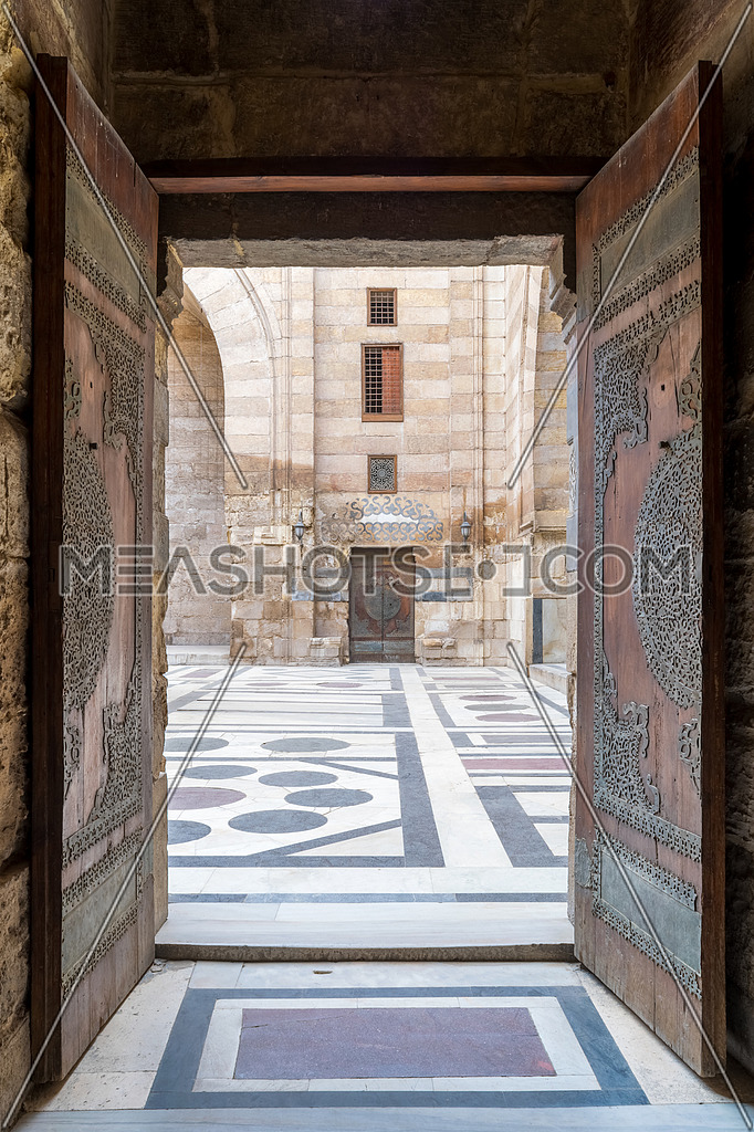 Opened door leading to the courtyard of Al-Sultan Al-Zahir Barquq mosque. Al-Moez Street, Old Cairo, Egypt
