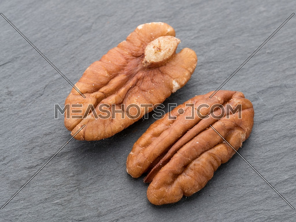 Close-up of a pecan peanut black stone background