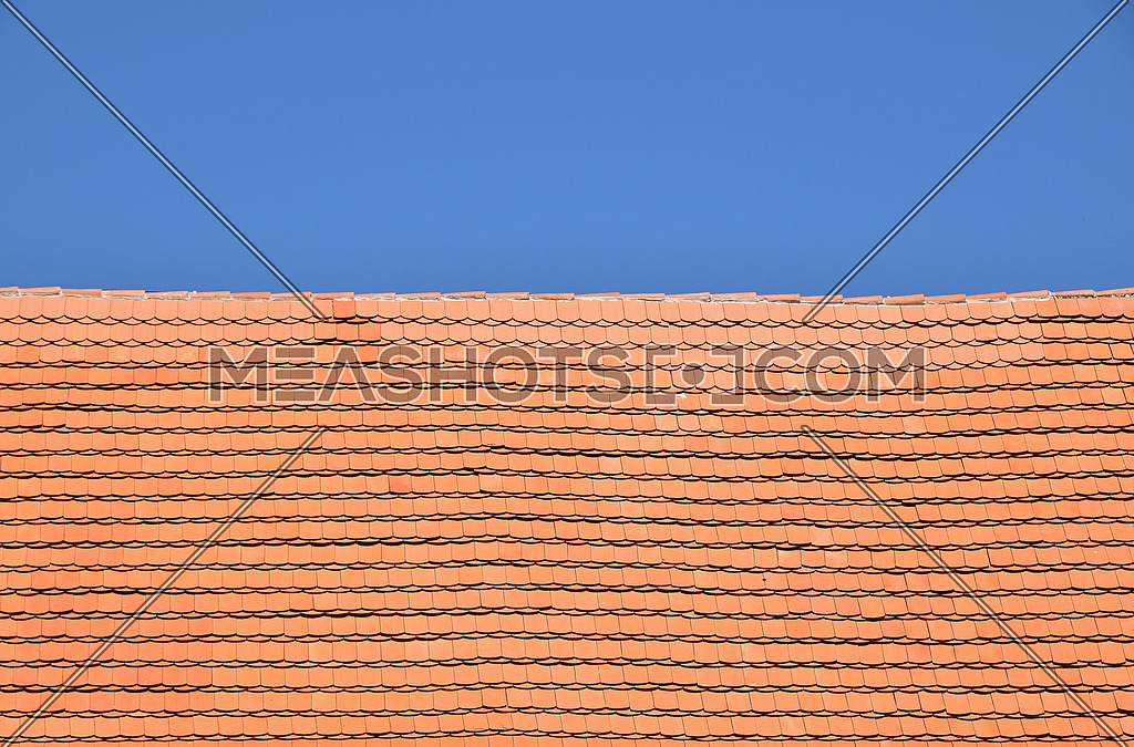 Red brown ceramic roof tiles over blue sky-175170 | Meashots