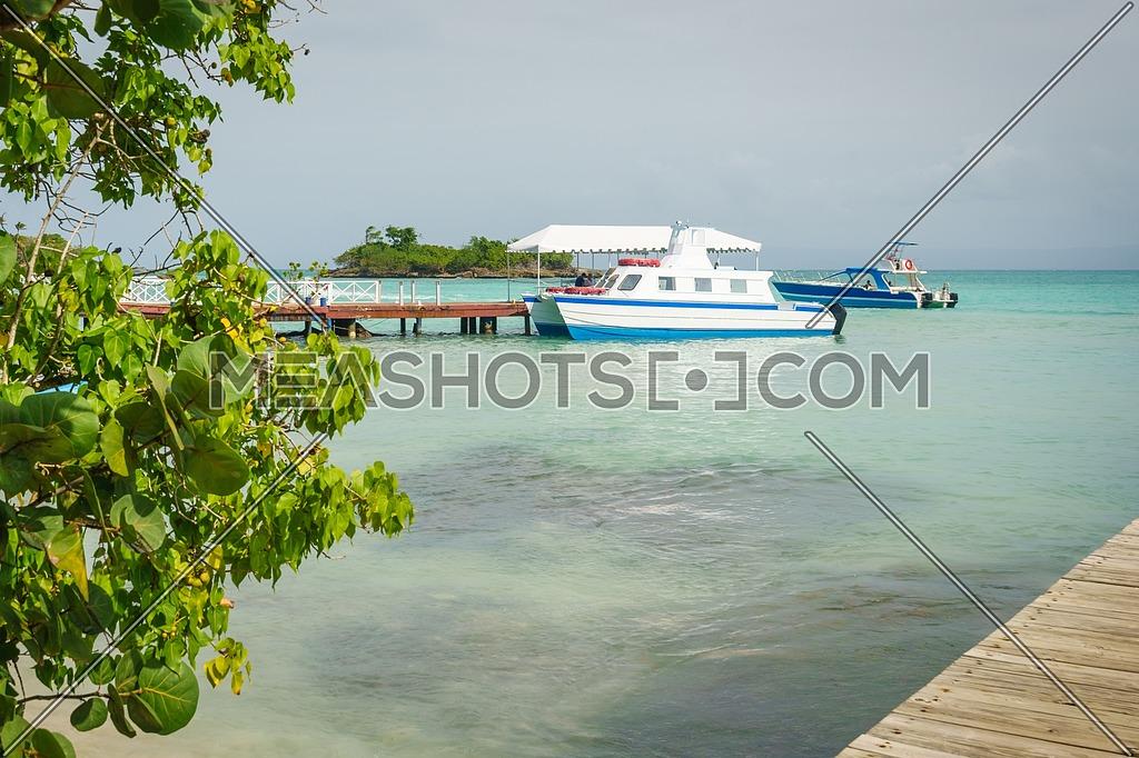 Cayo Levantado nickname Bacardi island, Small port with tourist ships and fishing boats moored,Samana peninsula,Dominican republic