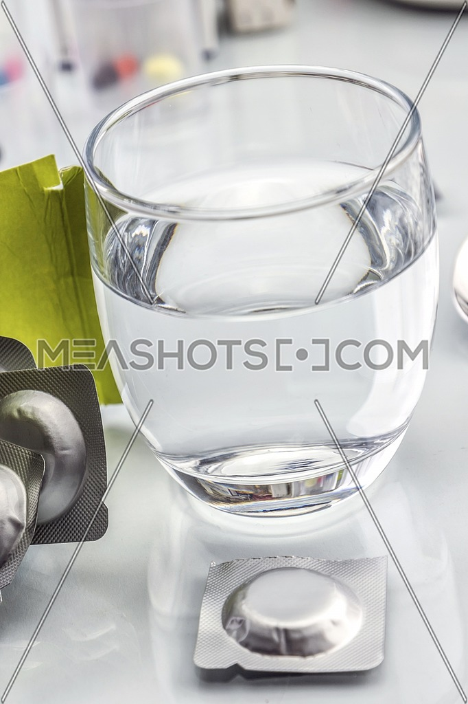 effervescent tablets and glass with water, conceptual image