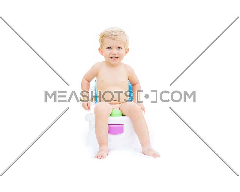 Kid white caucasian smiling and sitting on the potty with white background.
