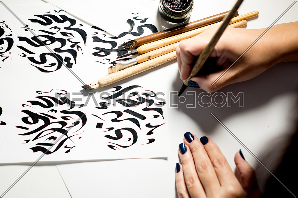 Arabic Calligraphy art Drawing names with Arabic Fonts using a wooden pen and ink paste