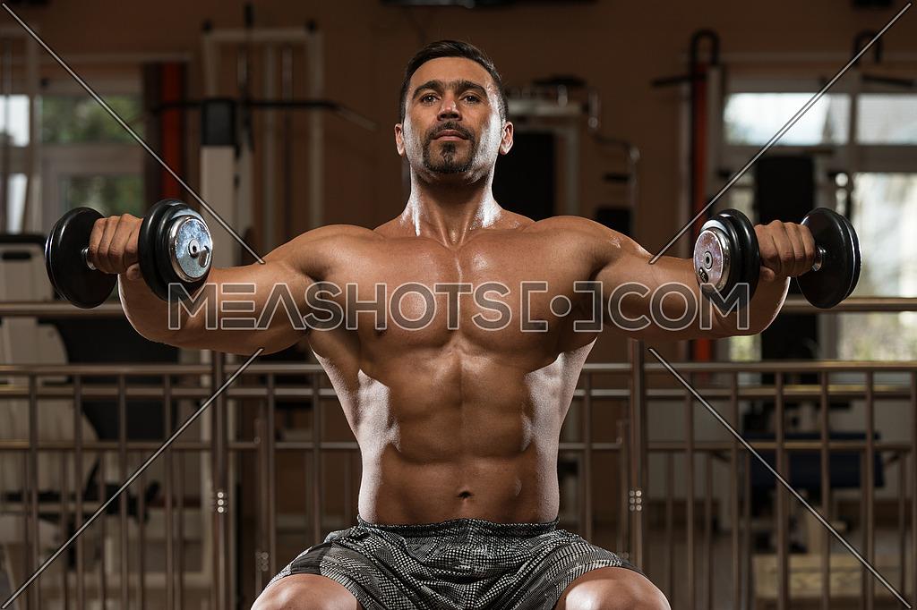 Hispanic Bodybuilder Working Out Shoulders - Dumbbell Concentration Curls