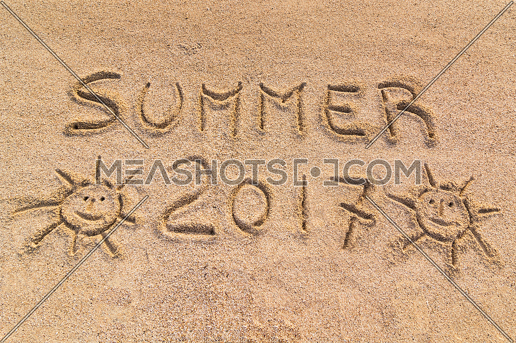 Summer 2017 sign, handwrite on sand.