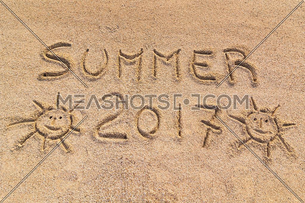 Summer 2017 sign, handwrite on sand.