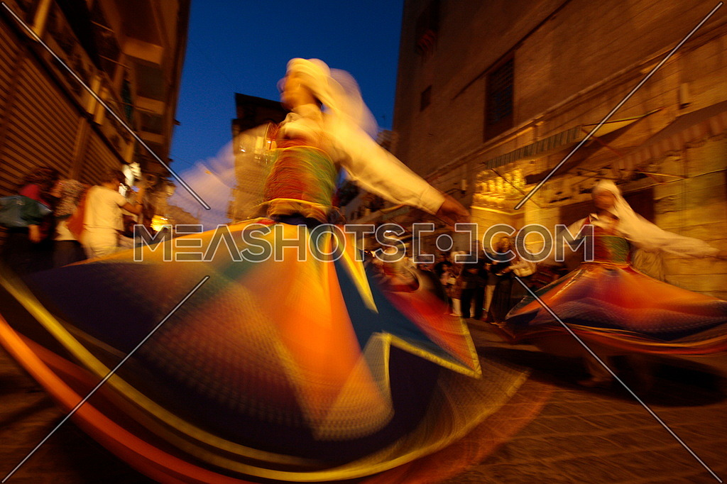celebrations of El Moez St. in Azhar, Cairo Egypt A man dancing wearing the folkloric tanoora