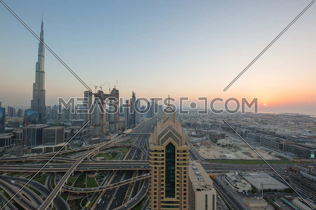 Long shot for Dubai City showing Burj khalifa in background and Roads at day