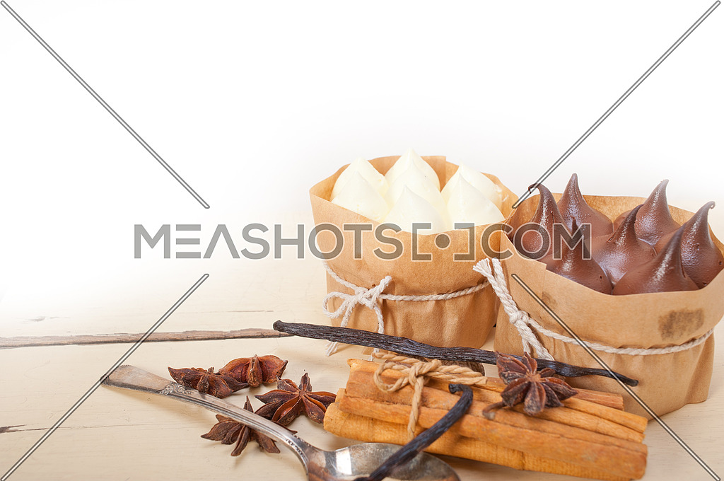 fresh baked chocolate vanilla and spices cream cake dessert over rustic wood table