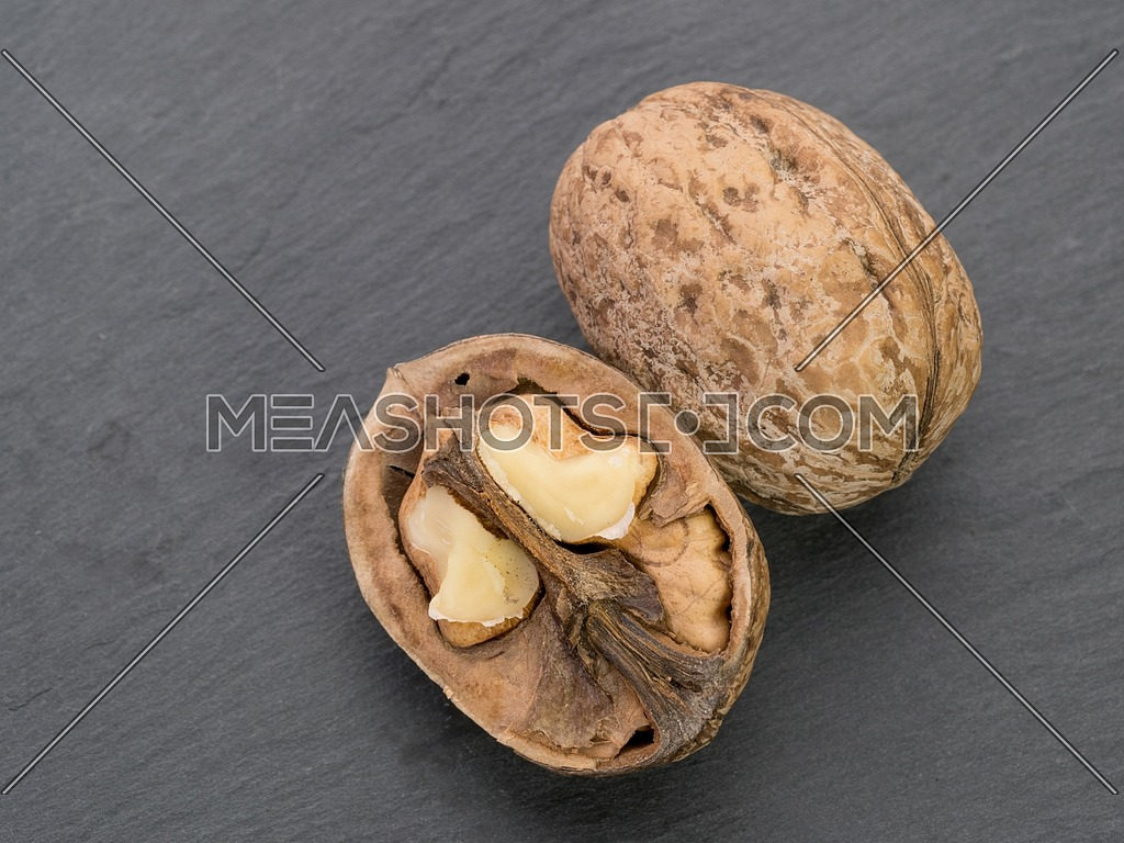 Close-up of a walnut on black stone background