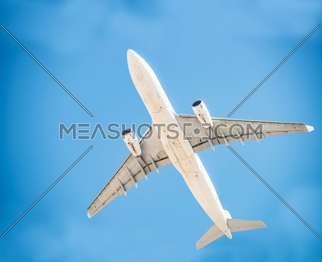 a low angle shot of an airoplane flying over