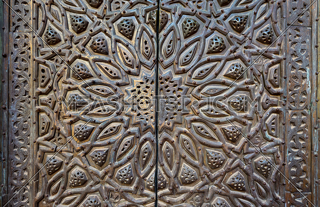 Ornaments of the bronze-plate ornate door of minbar (platform) al Sultan Hasan public mosque, Old Cairo, Egypt