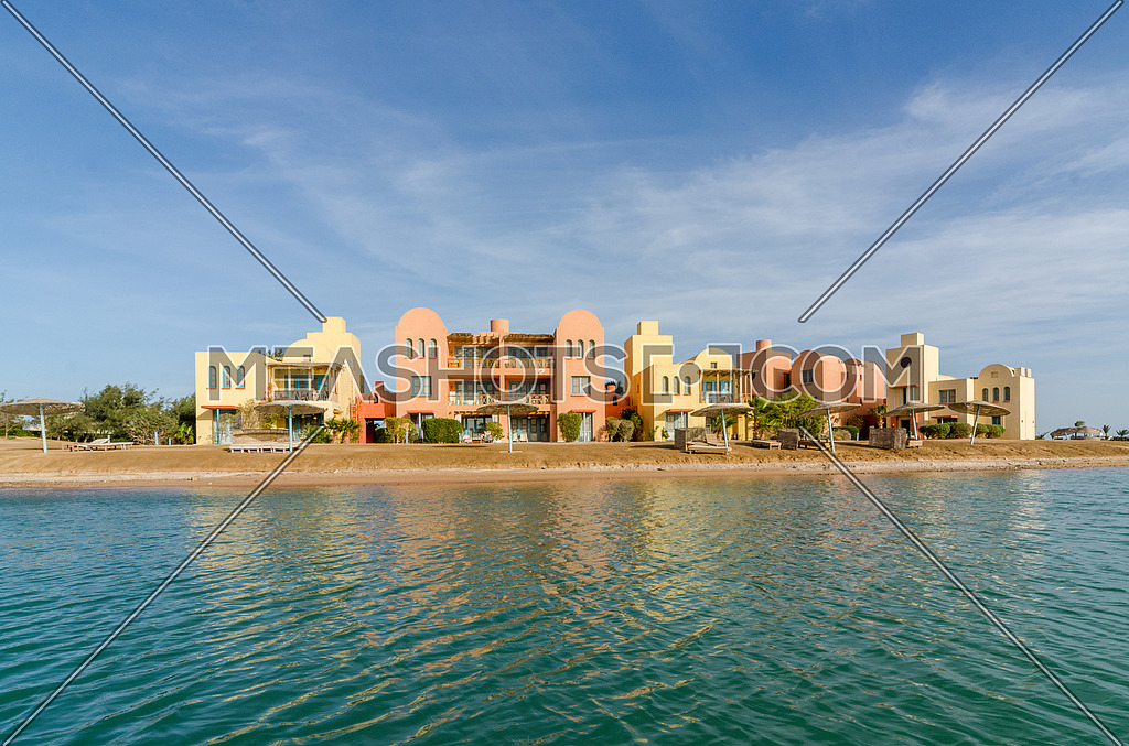Long shot from water side for a villa the city of gouna, hurghada, egypt at day