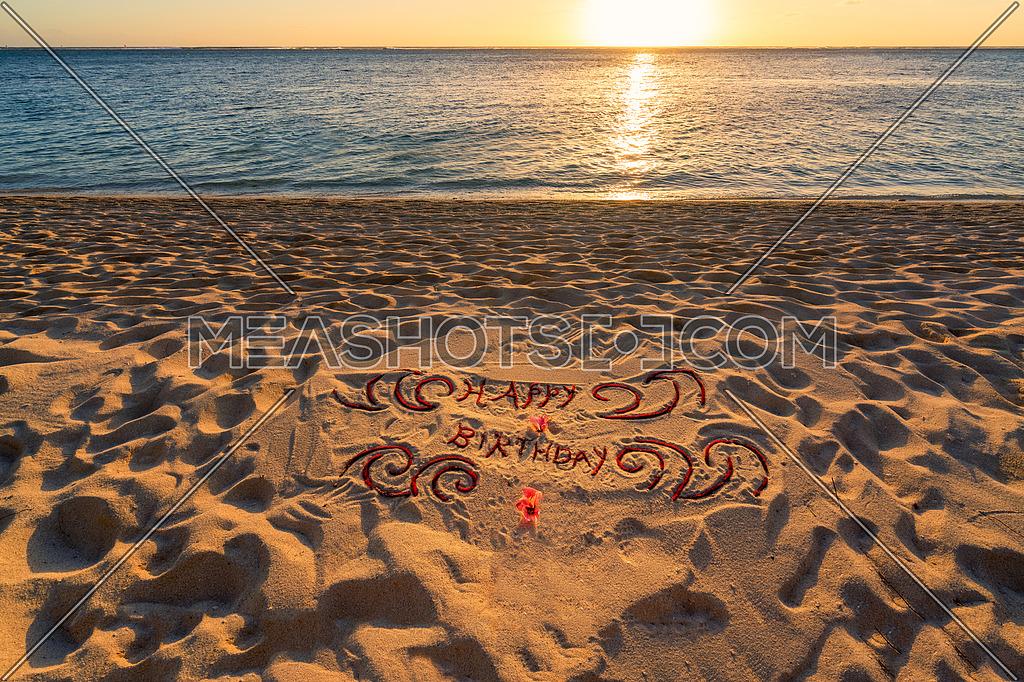 Handwritten on the sand