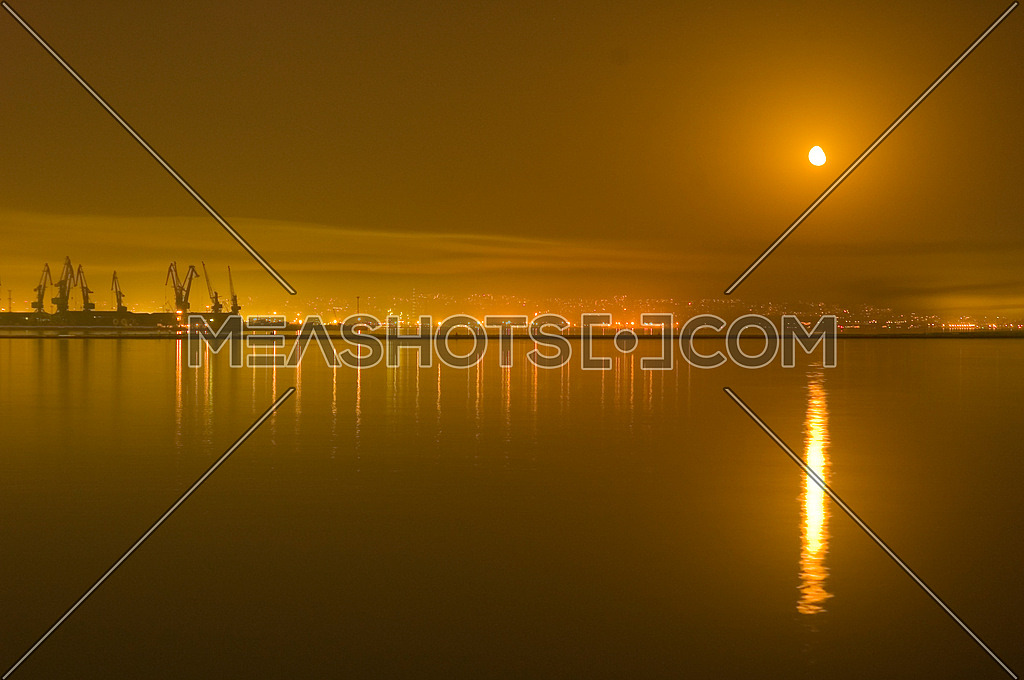 Reflections of city and moon in the Caspian Sea - Baku, Azerbaijan