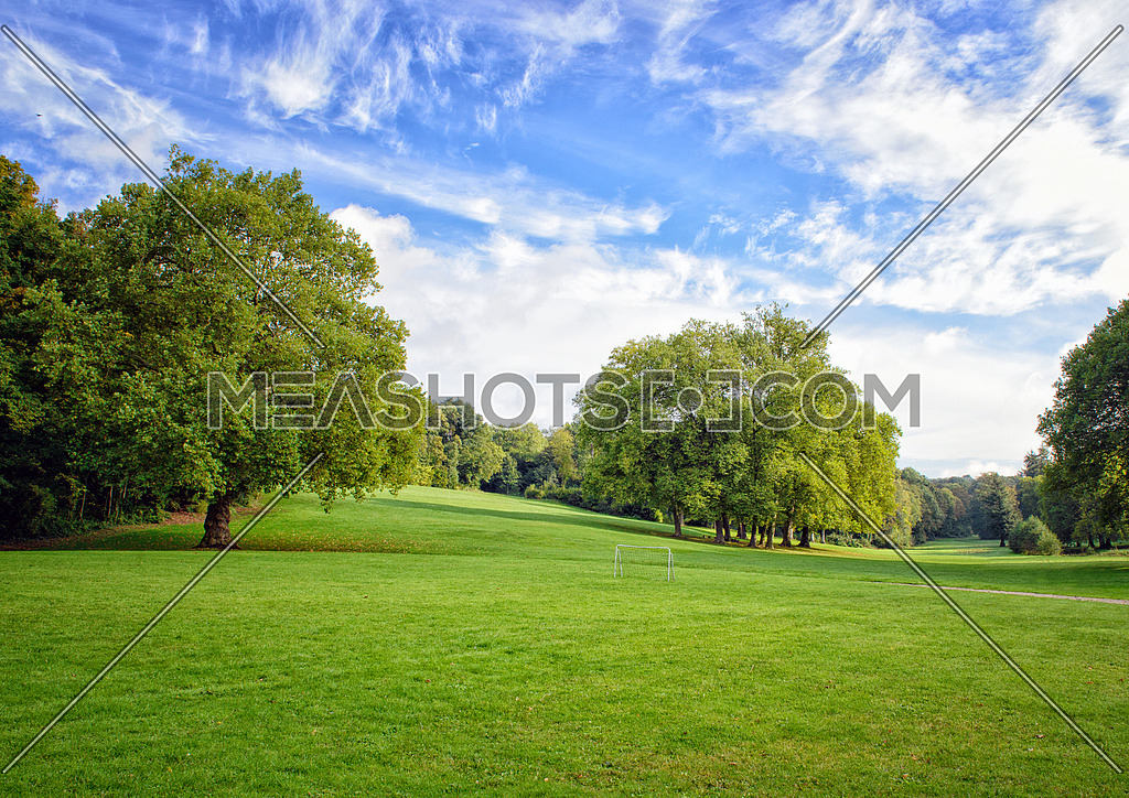 Green trees landscape with beautiful sky and clouds