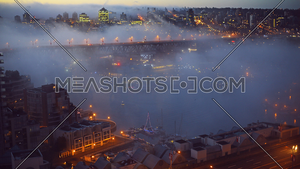 Fog over the city of Vancouver during sunrise