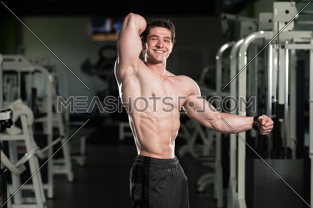 Photo For Bodybuilder Posing In Different Poses Demonstrating Their