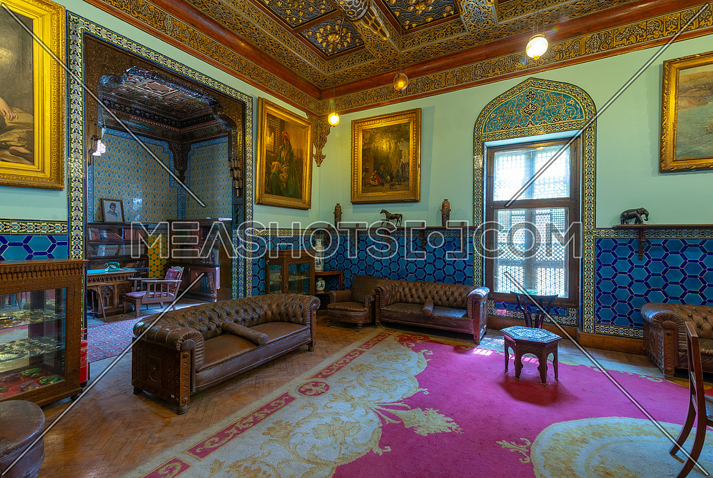 Manial Palace of Prince Mohammed Ali. Living room at the residence building with Turkish floral blue pattern ceramic tiles, vintage furniture, European style paintings, Cairo, Egypt