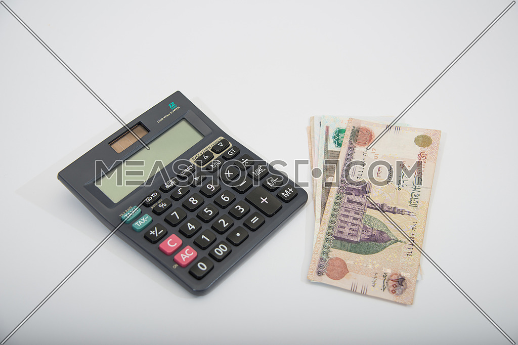 black calculator and egyptian money