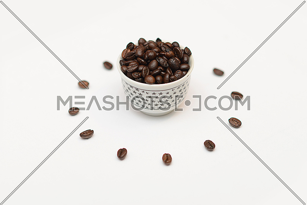 an abstract setup of coffee beans in a bowl