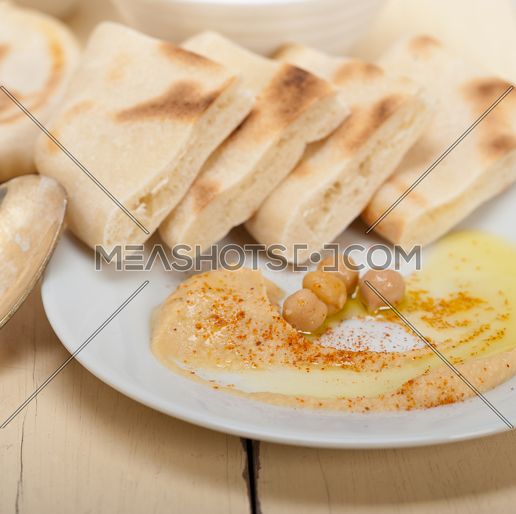 traditional chickpeas Hummus with pita bread and paprika on top