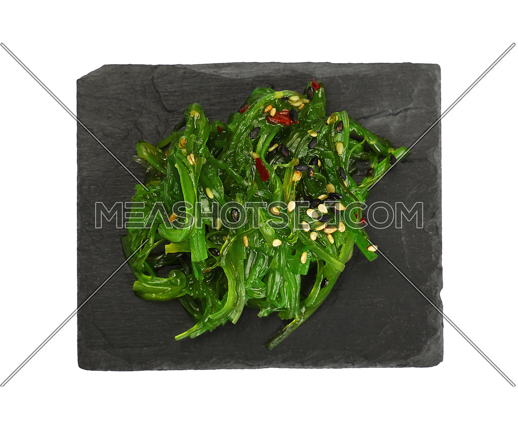 Close up portion of green wakame seaweed salad