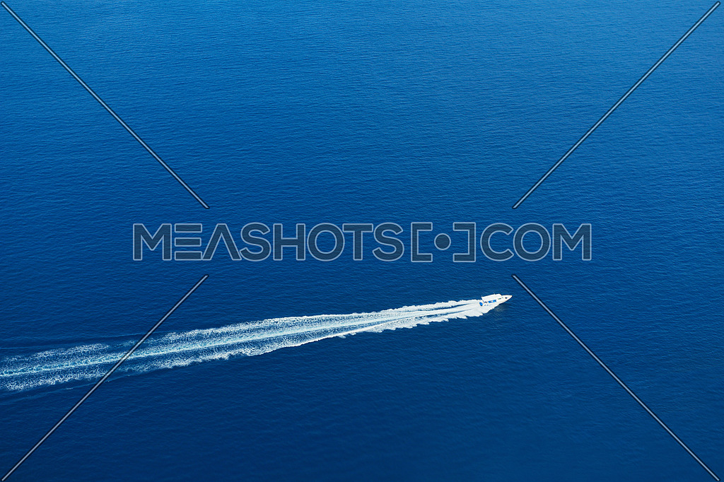 fast motor speed boat travel with splash and wake on blue tropical sea backround
