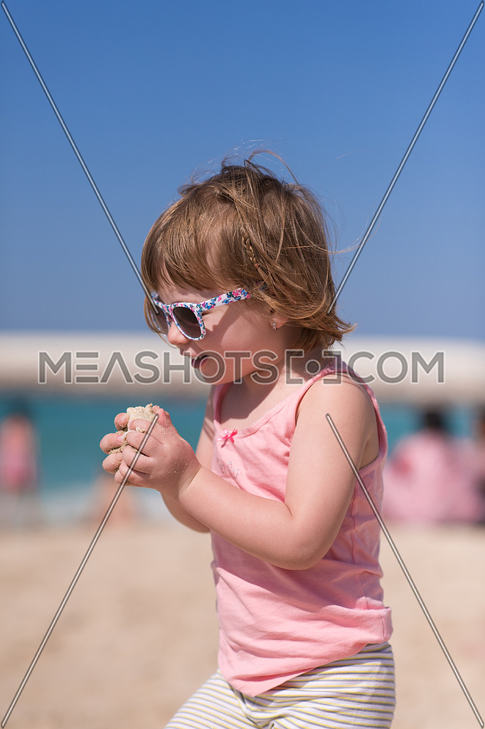 3df26421562f happy little girl at the seaside in the summer.Adorable little girl at  beach during