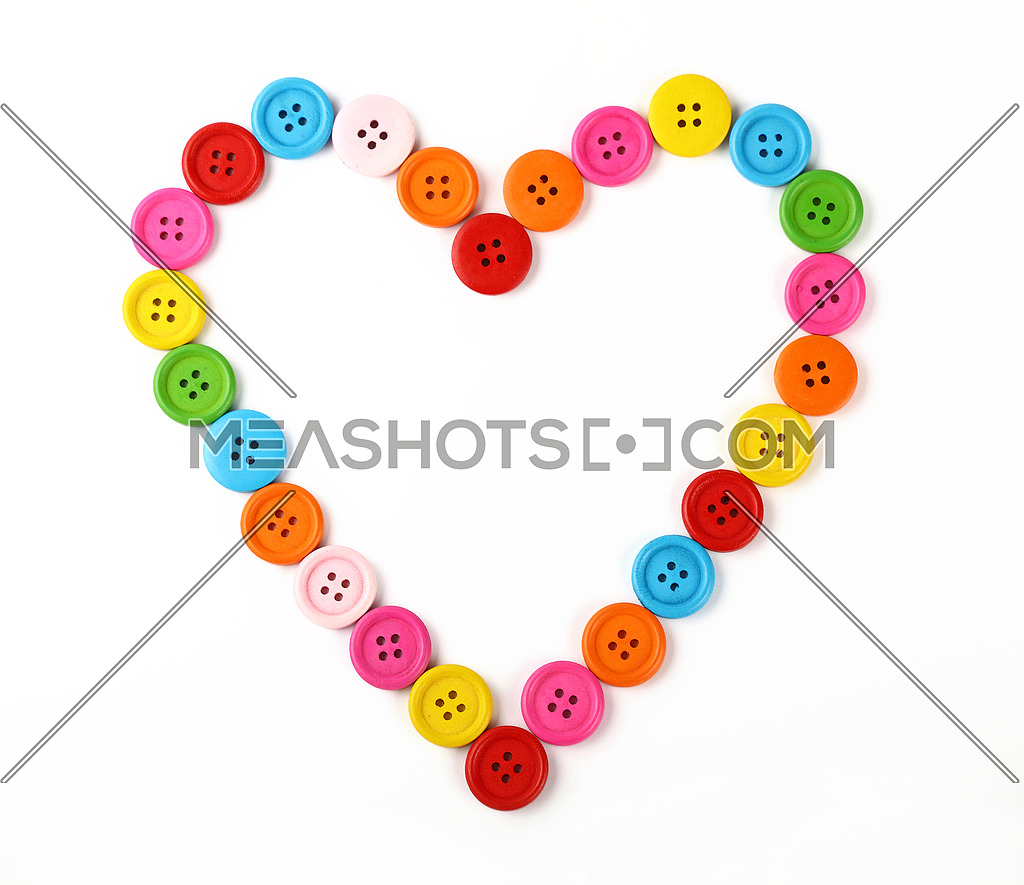 Heart shaped of colorful sewing buttons on white-122962