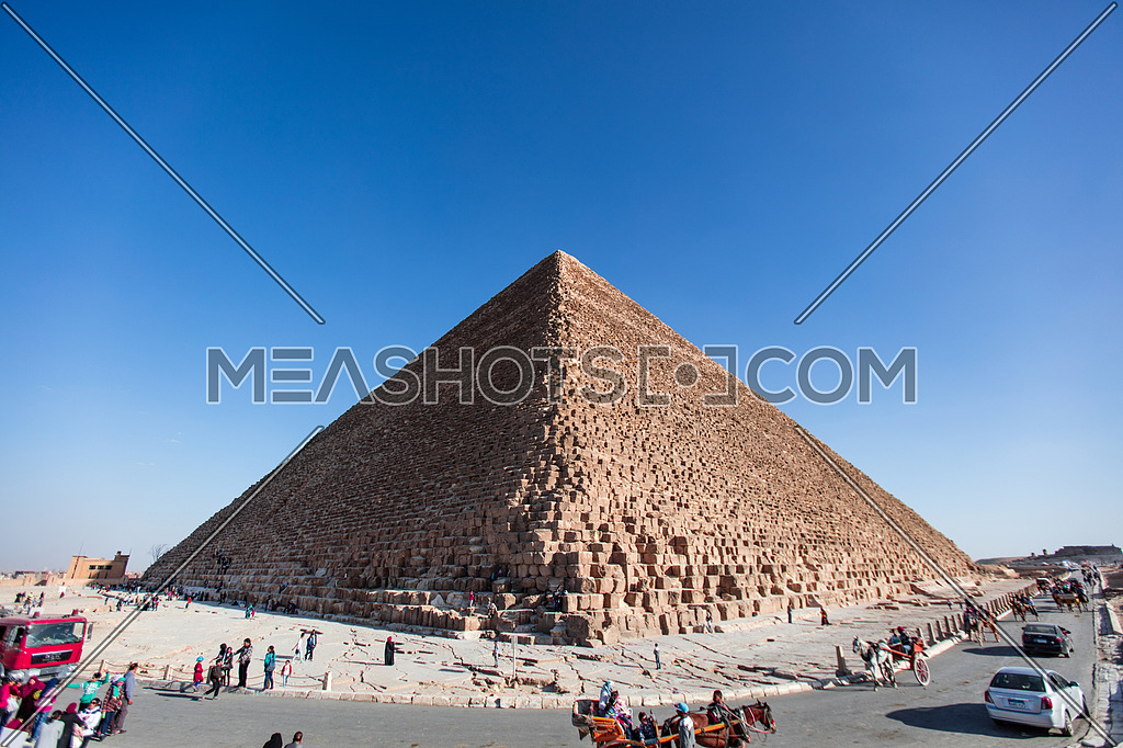 The View of the Giza Pyramids in Egypt in a blue sky.
