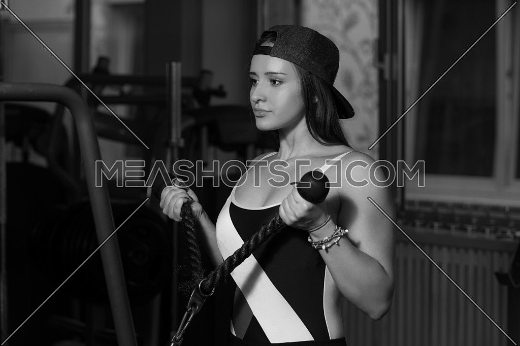 Young Woman Doing Heavy Weight Exercise For Biceps