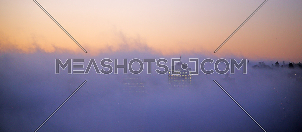 fog showing bits of Vancouver skyscrapers