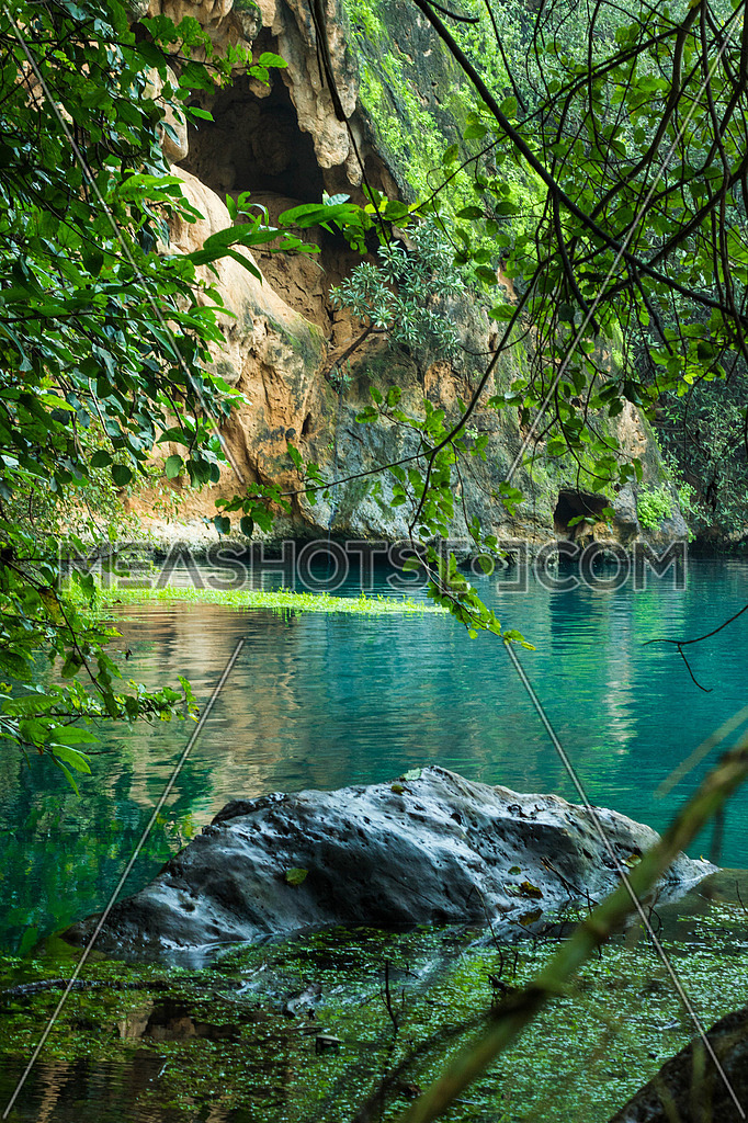 A water pond by the rocks