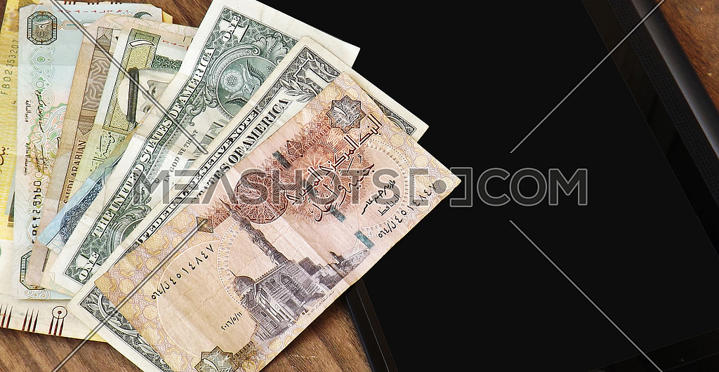 1 Doller And Egyptian Pound On Wood Background Tablet