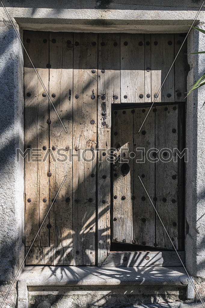 Typical wooden door in a medieval style house, Trujillo, Caceres Province, Spain
