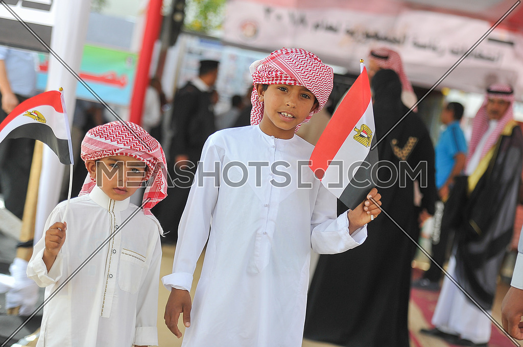 Children of Sinai Bedouins holding egyption flag waiting for their father to go out after voting in the presidential elections of 2018 in the city of peace Sharm El-Sheikh in South Sinai on the first day of the elections 26 March 2018, which lasts for 3 days