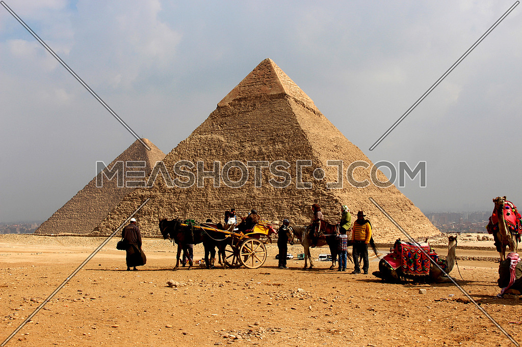 a photo from the Pyramids of Giza showing the great and middles pyramids , belonging to ancient Egypt history & civilization