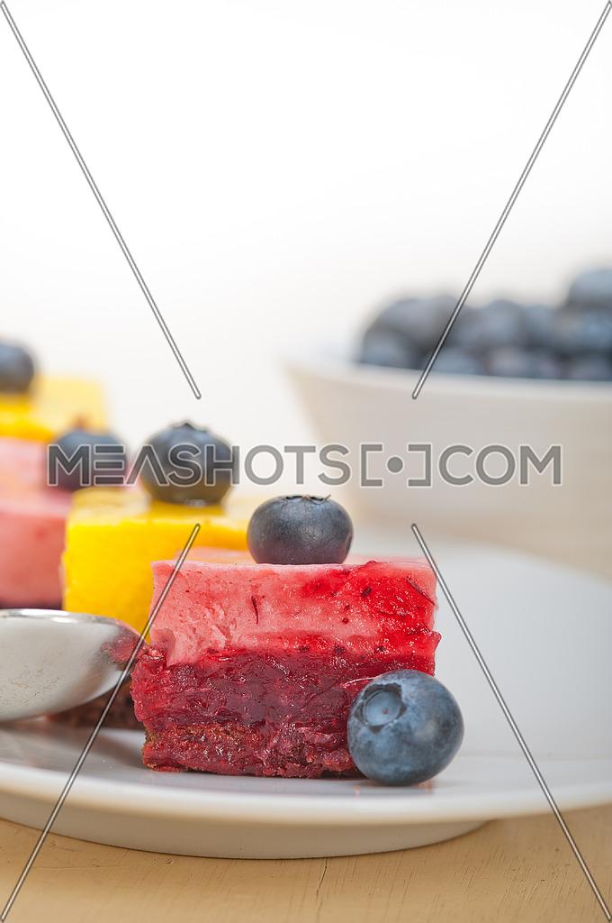 fresh strawberry and mango mousse dessert cake with blueberry