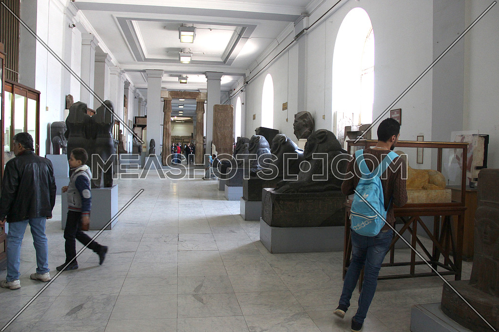 a photo from inside the Egyptian museum showing some monumental statues and visitors -- editorial value comes from tourism news