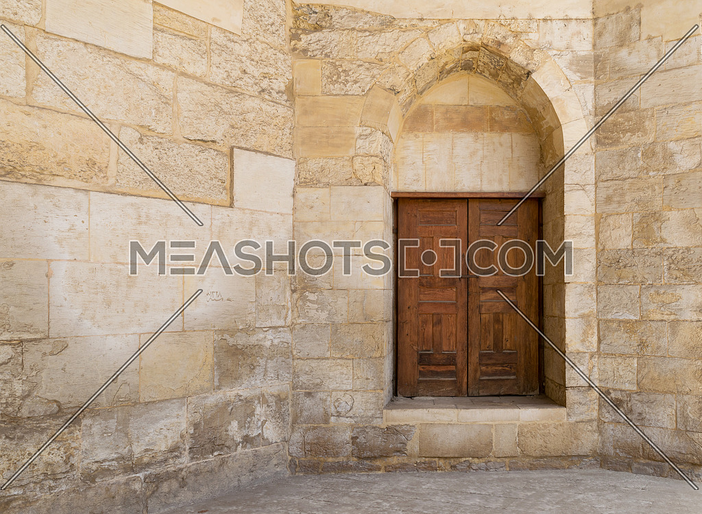 Old wall with a historic decorated wooden door, Cairo, Egypt