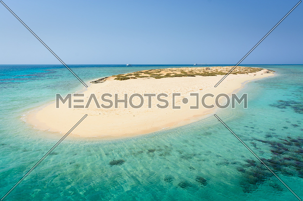 In the picture an atoll with fine white sand, turquoise sea,situated in the Red Sea in Egypt,between the area of Hamata and Berenice.